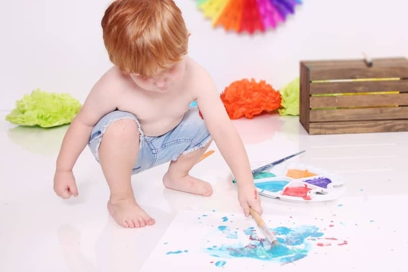 toddler splashing paint