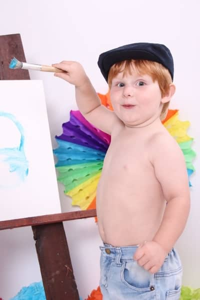 toddler painting on canvas