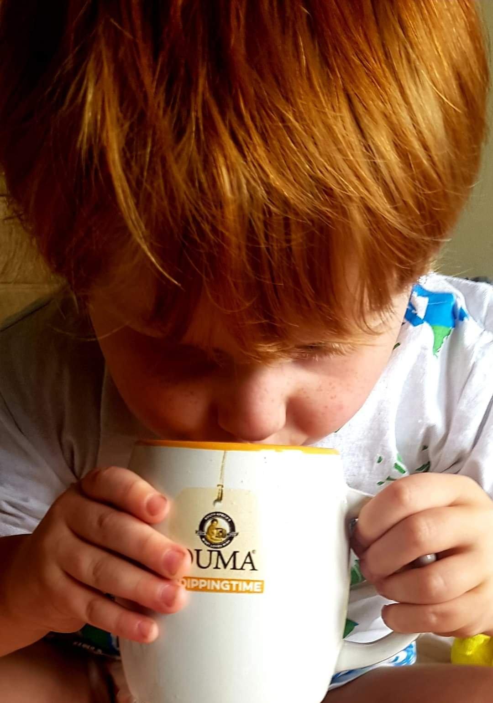 Boy drinking from mug